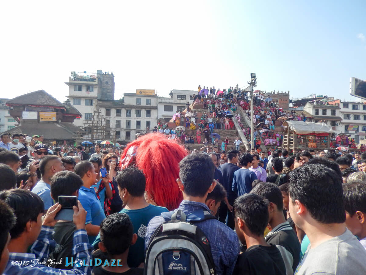 Musicians and elaborately dressed dancers work their way through the crowds at the Indra Jatra festival 2015
