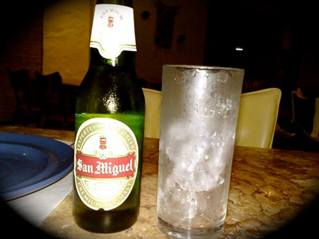 San Miguel beer with a class of ice, in proper Filipino form