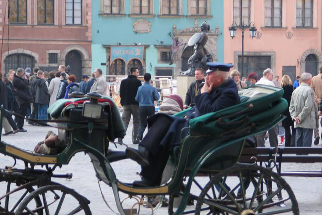One of the must-do Krakow excursions your first time in Poland is a dorozka ride