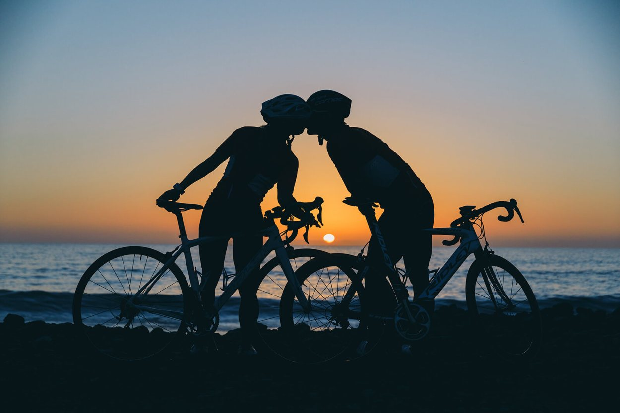 Pair of cyclists reached the beach just in time to see beautiful sunrise