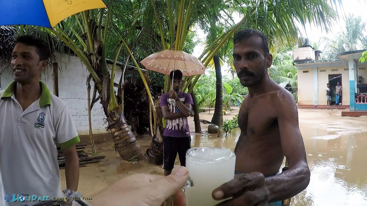 Being presented with a fresh glass of 5% alcohol toddy. Trincomalee, Sri Lanka