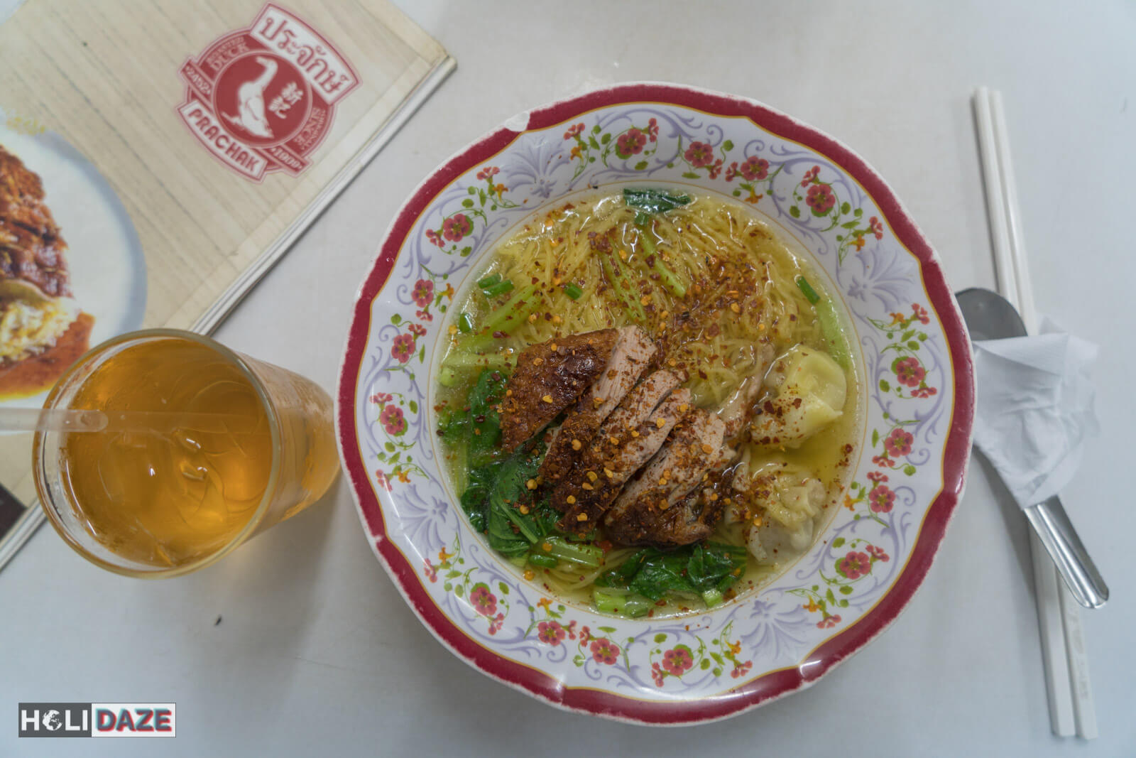Roast duck noodle soup with pork wontons and ice tea at Prachak in Bangrak, Bangkok