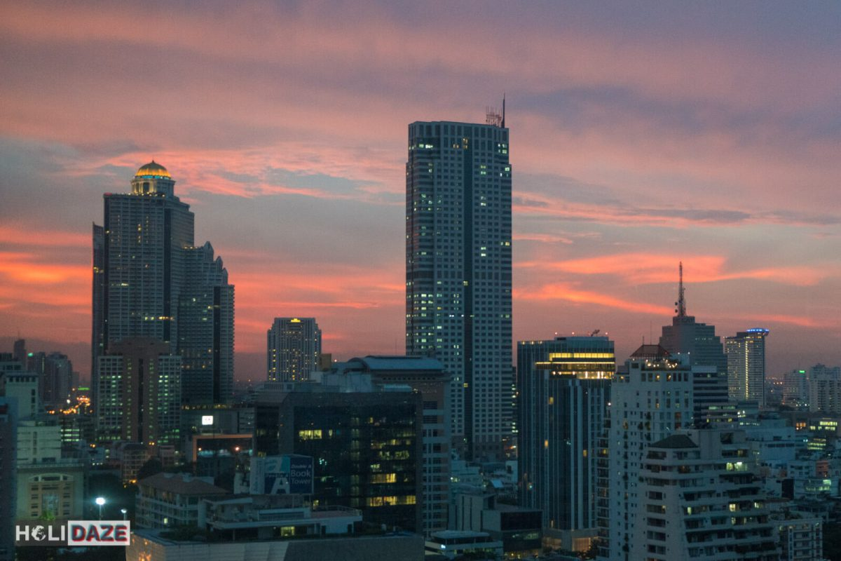 Bangkok skyline sunset view of the Sky Bar as seen from my suite at the top floor of the Ascott Sathorn