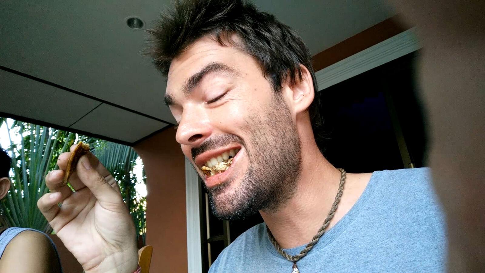 Derek Freal eating cockroaches
