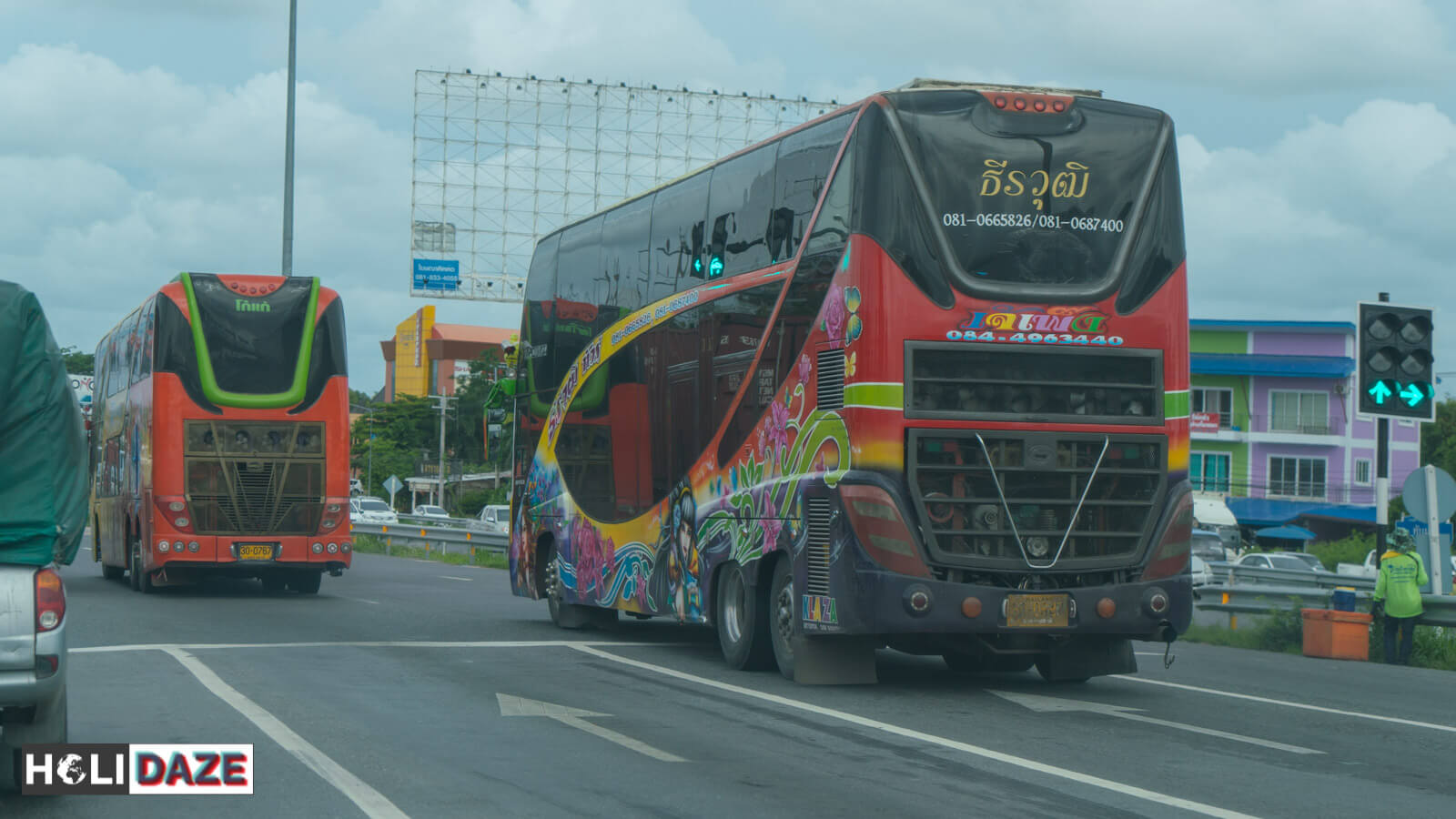 Thai buses driving down the highway
