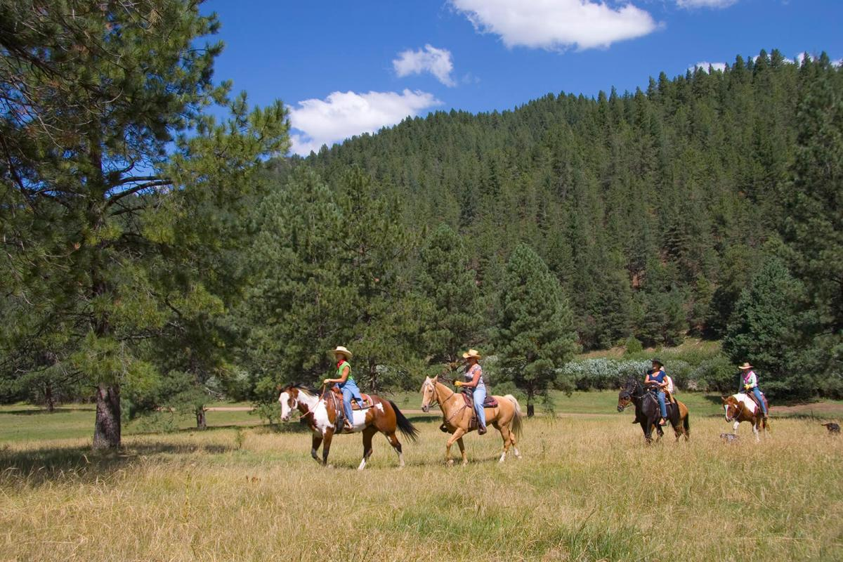 Horseback riding around Grindstone Lake is one of the many unique and off the beaten path summer activities in Ruidoso, New Mexico