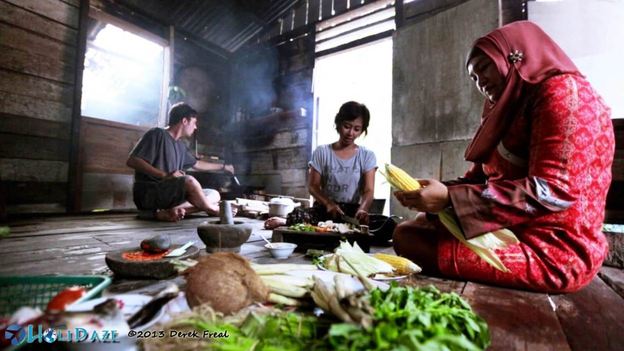 Derek Freal and Riyanni Djangkaru cook dinner with locals in Sumatra