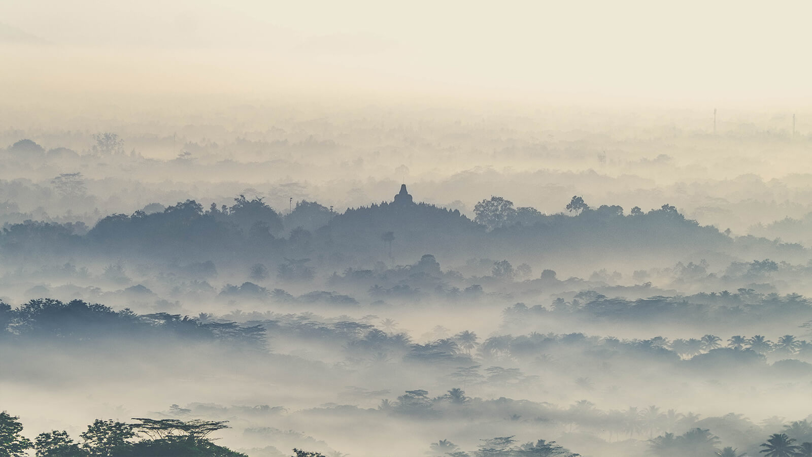 Cloudy morning sunrise over Borobudur Temple in Indonesia, a world famous UNESCO site