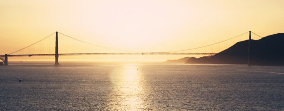 Sunset view of the Golden Gate Bridge from Alcatraz prison in the San Francisco Bay, California