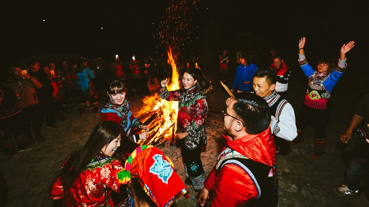One of the best things about solo travel is making new friends, like at this late night bonfire dancing with locals up on Jiaozi Snow Mountain in Kunming, Yunnan, China