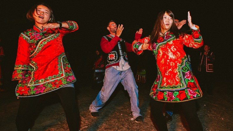 Late night bonfire and dancing with locals at Jiaozi Snow Mountain in Kunming, Yunnan, China