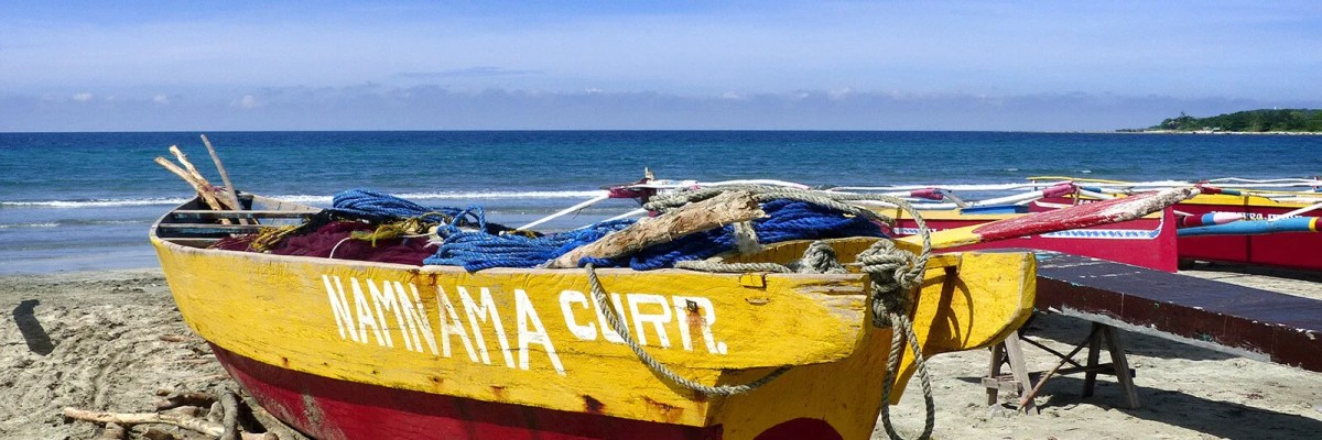 Fishing boats on the beach at Currimao in Ilocos Norte, Philippines