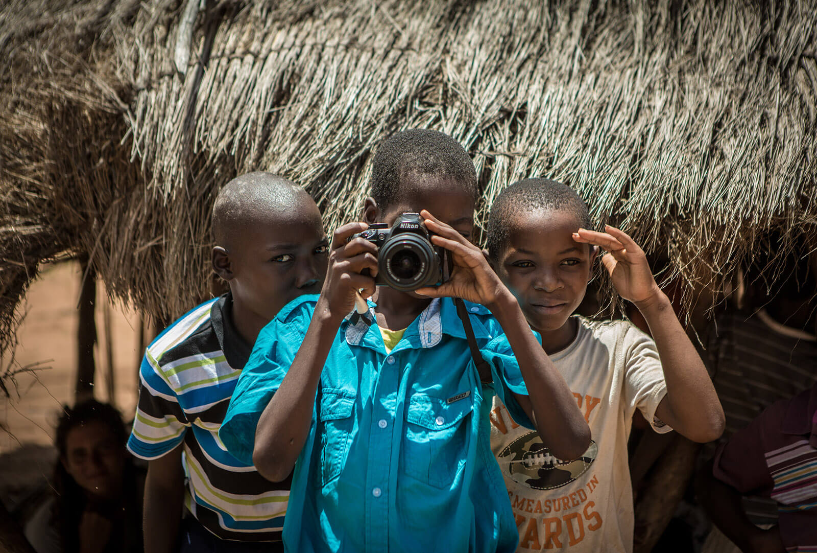 Mozambique kids with a camera taking photos