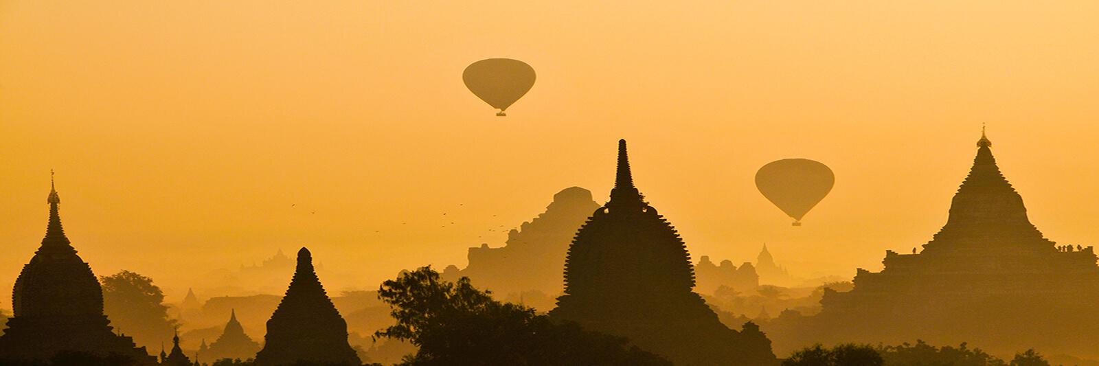 Hot air ballons over old Bagan, Myanmar at sunset