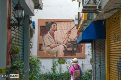 Tourist taking a photo of a tribute to a famous Korean artist in Chang-dong Art Village