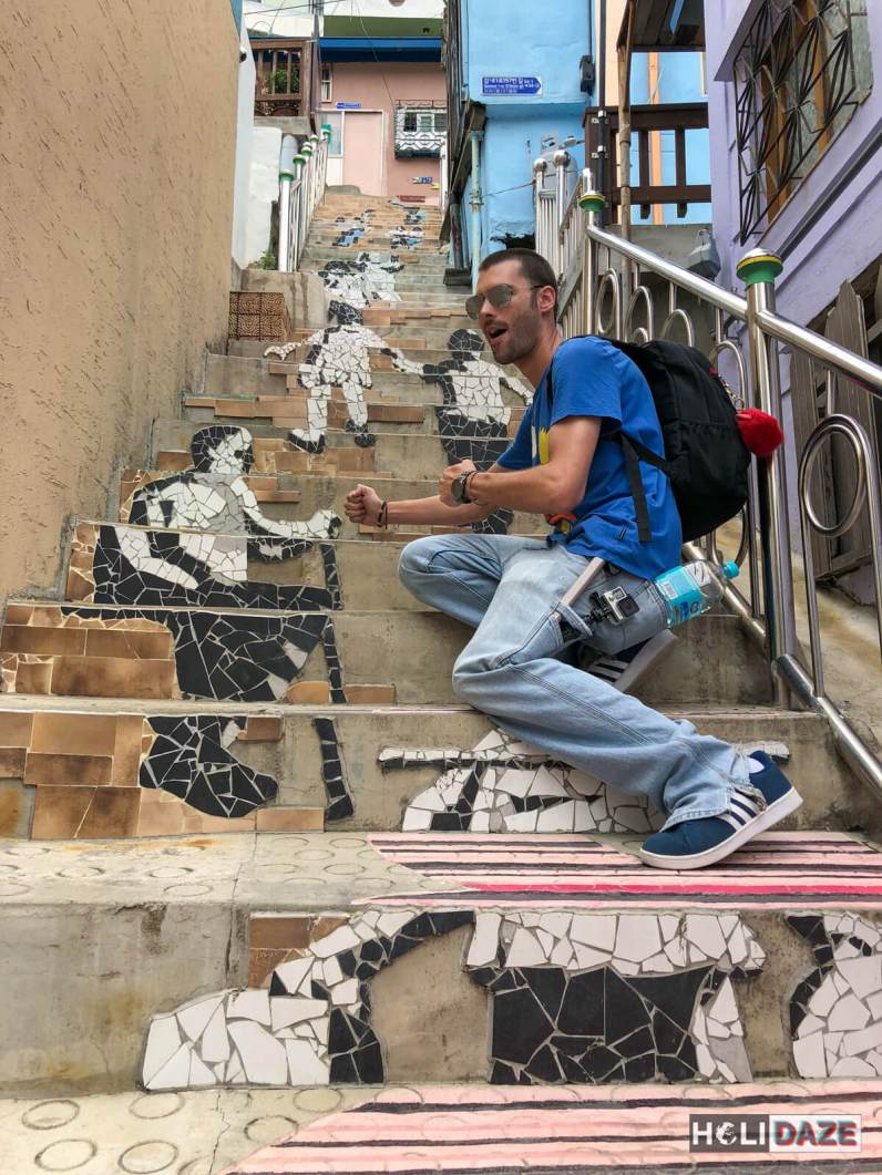 """Derek Freal fighting with the """"step-art"""" on the Stairs To See Stars at Gamcheon Culture Village in Busan, South Korea"""