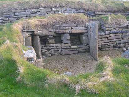 Knap Of Howar homestead, which consists of two roughly rectangular stone rooms side by side, linked by an internal door, and with doors to the outside at the west end, is partly subterranean, and virtually complete to roof height.