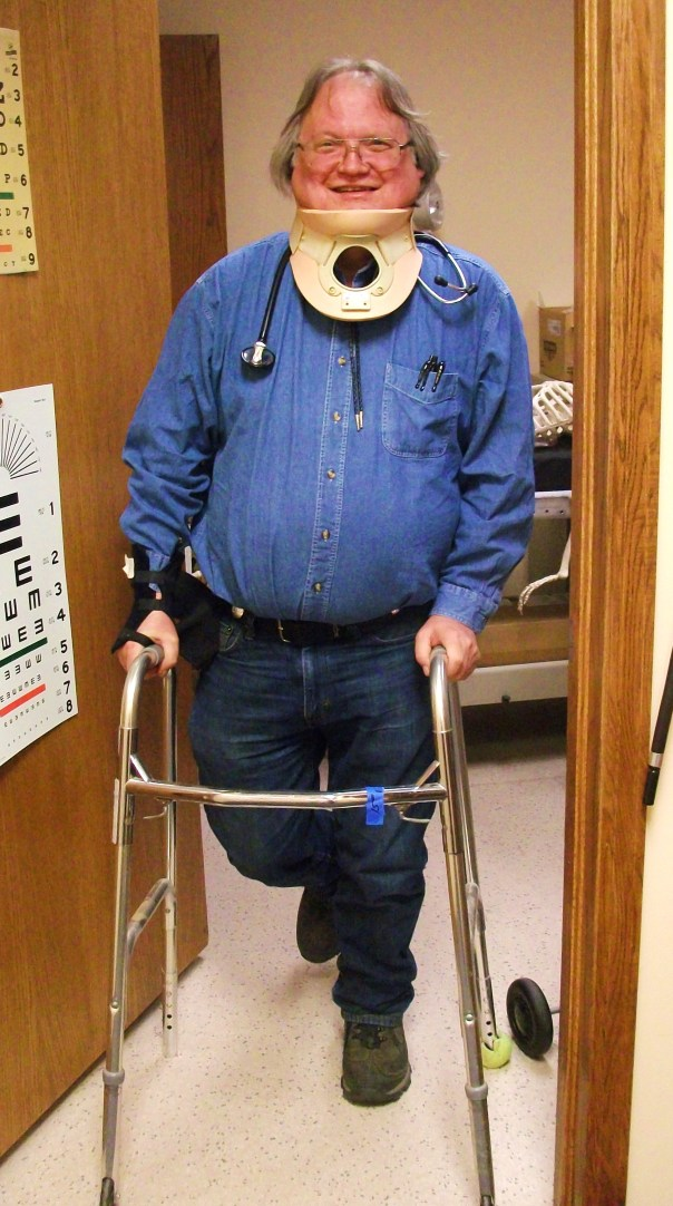 doctor standing with walker, stethoscope, neck brace, and walking boot