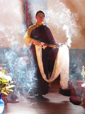 A Tibetan Buddhist Nun, Ani Pema (Arwen Ek) using incense as an offering in a Tibetan Buddhist ritual.