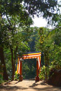Buddhist flags on gate to temple, Sri Lanka