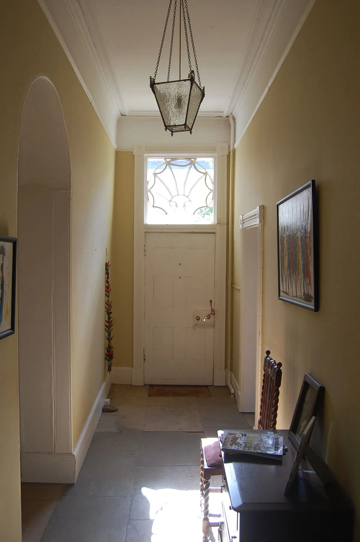 Laura Bingham and Ed Stafford's entrance hall with glass lantern pendant light at their grade II listed house in Hallaton, Leicestershire