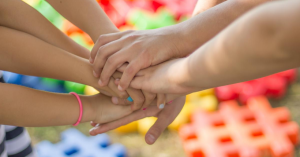 Large Family Homeschooling - hands in image