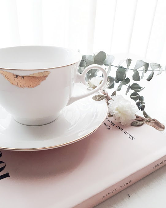 teacup and pink book