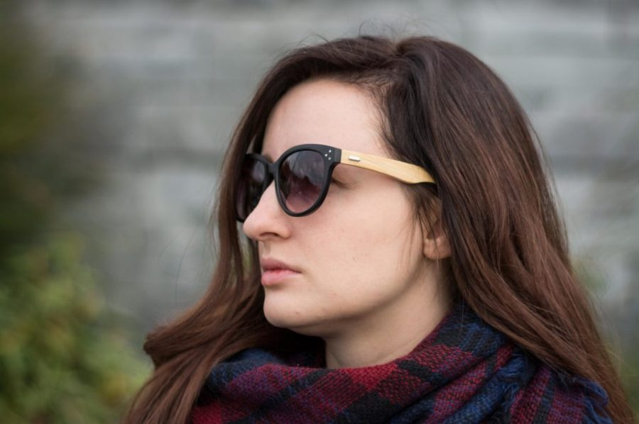 Woman wears fall colored blanket scarf and eco friendly sunglasses for eco OOTD