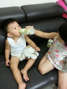 """Please learn to drink from the bottle, or I'll tell mummy you've been naughty when she gets back!"""
