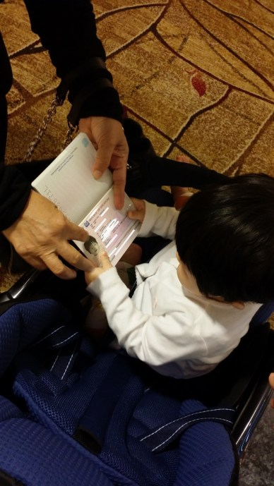 Vera acknowledging her passport when we returned from Taiwan recently. LOL!