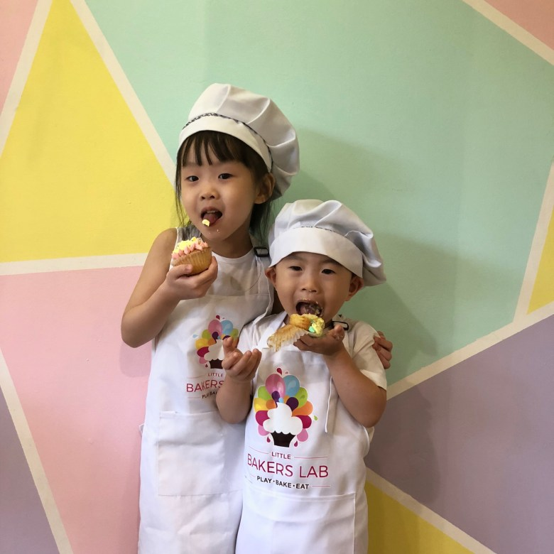 kids decorate cupcakes at baking class singapore