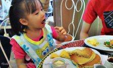Enjoying her pancakes