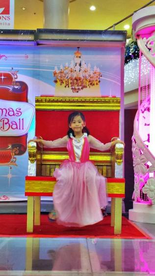 The princess in the Kiddie Ball throne