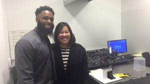 Mike Davis and May H. Graduate Students in one of the Optics Labs. (Photo Credit: Nettiesha Scott)