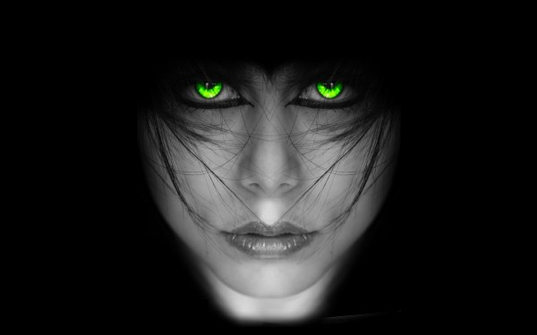 Girl with Glowing Green Eyes