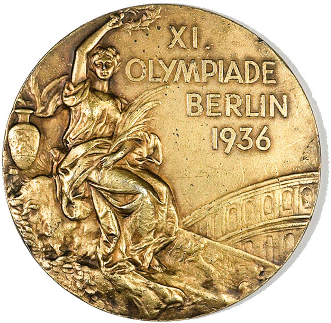 "The Olympic gold medal awarded to John Haskell ""Tex"" Gibbons for his role in propelling the United States basketball team to victory in 1936. Gibbons was 28 at the time. The medal is double-sided and gold-plated and measures just over two inches in diameter."