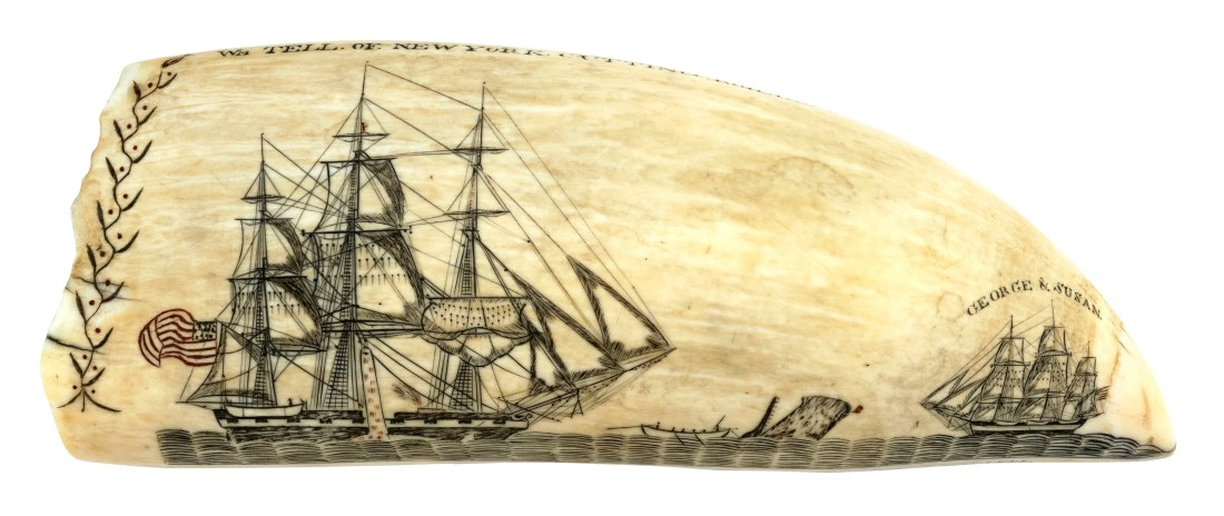 """A scrimshaw whale's tooth by Edward Burdett, made in the early 1830s and inscribed, in block letters, """"Engraved by Edward Burdett of Nantucket Onboard the Ship William Tell."""" It shows a scene of the William Tell capturing a whale while another ship, the George and Susan, floats nearby. On the back, it shows another whaleship, the William Thomson, sailing near a coastline."""