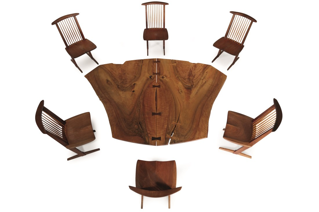 "A Sanso ""Reception House"" table and six Conoid chairs, designed and made by George Nakashima in 1981. The table is 28 inches high, 60 inches wide, and 84 1/2 inches in diameter. All seven pieces are signed with the surname of the client."