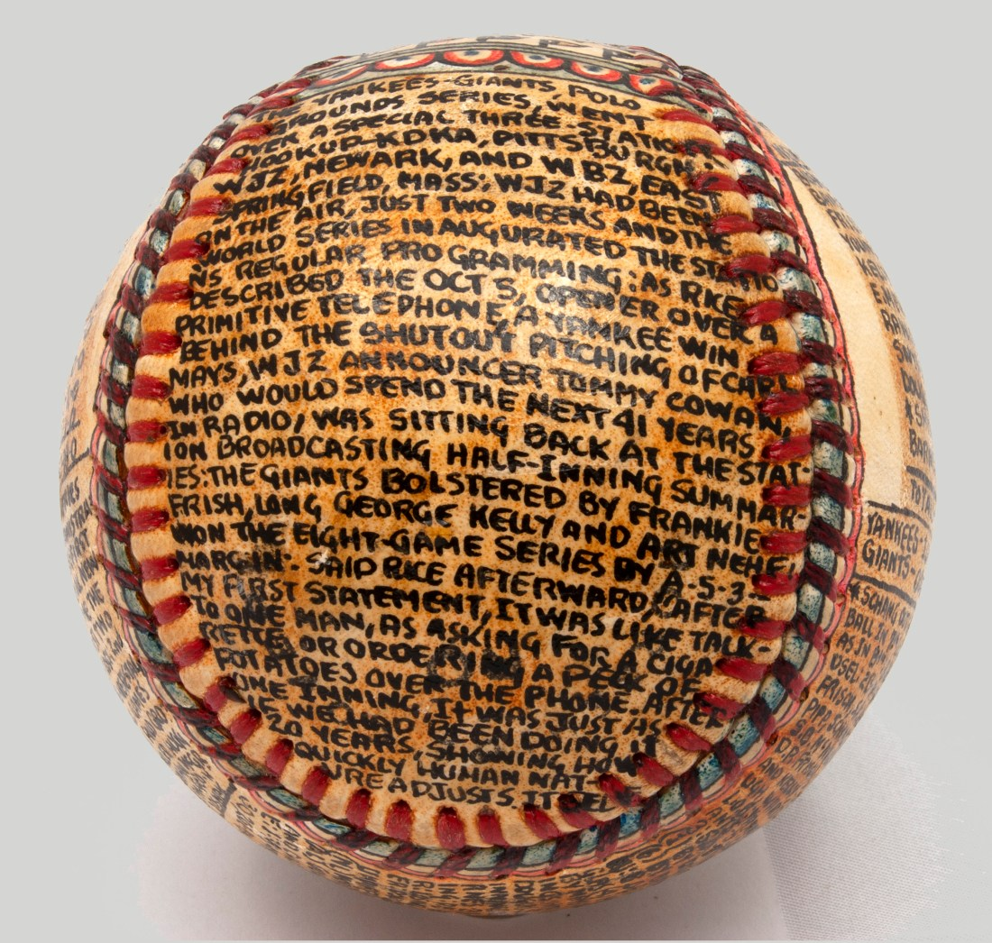 A baseball transformed by self-taught artist George Sosnak. This angle shows how Sosnak crammed a recap of the 1921 World Series within the borders of this seam of the ball.