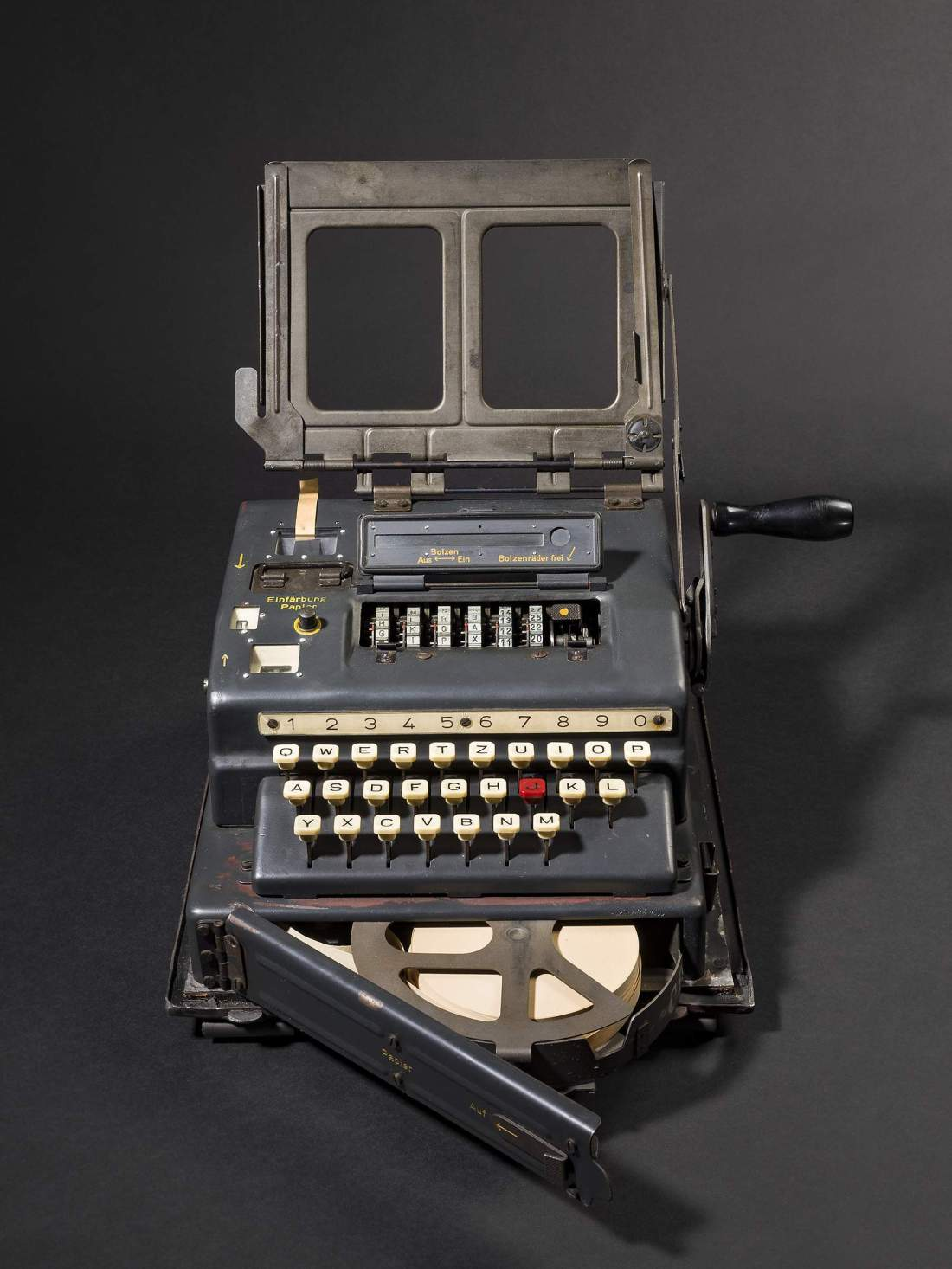 A closer shot of the Schlüsselgerät 41, with its keyboard visible. The bottom door is open, showing a spool of white paper.