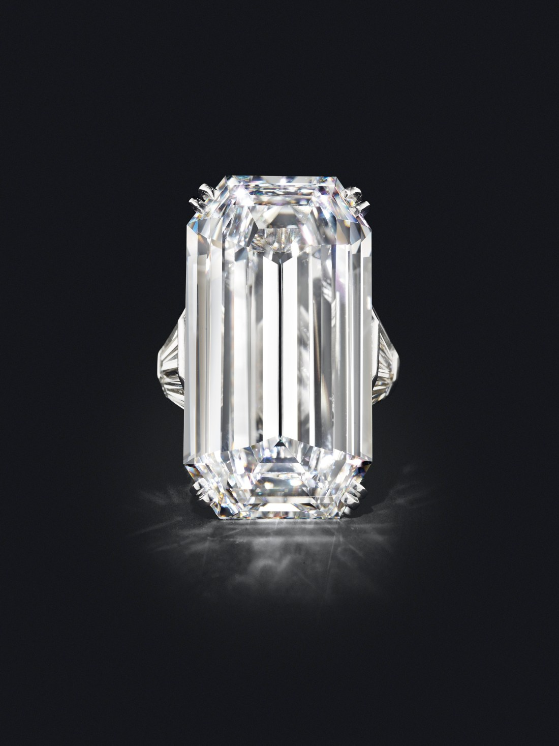 The Mirror of Paradise 52.58-carat Golconda diamond, shown in full on a black background. Part of the ring setting is visible on either side of the stone.