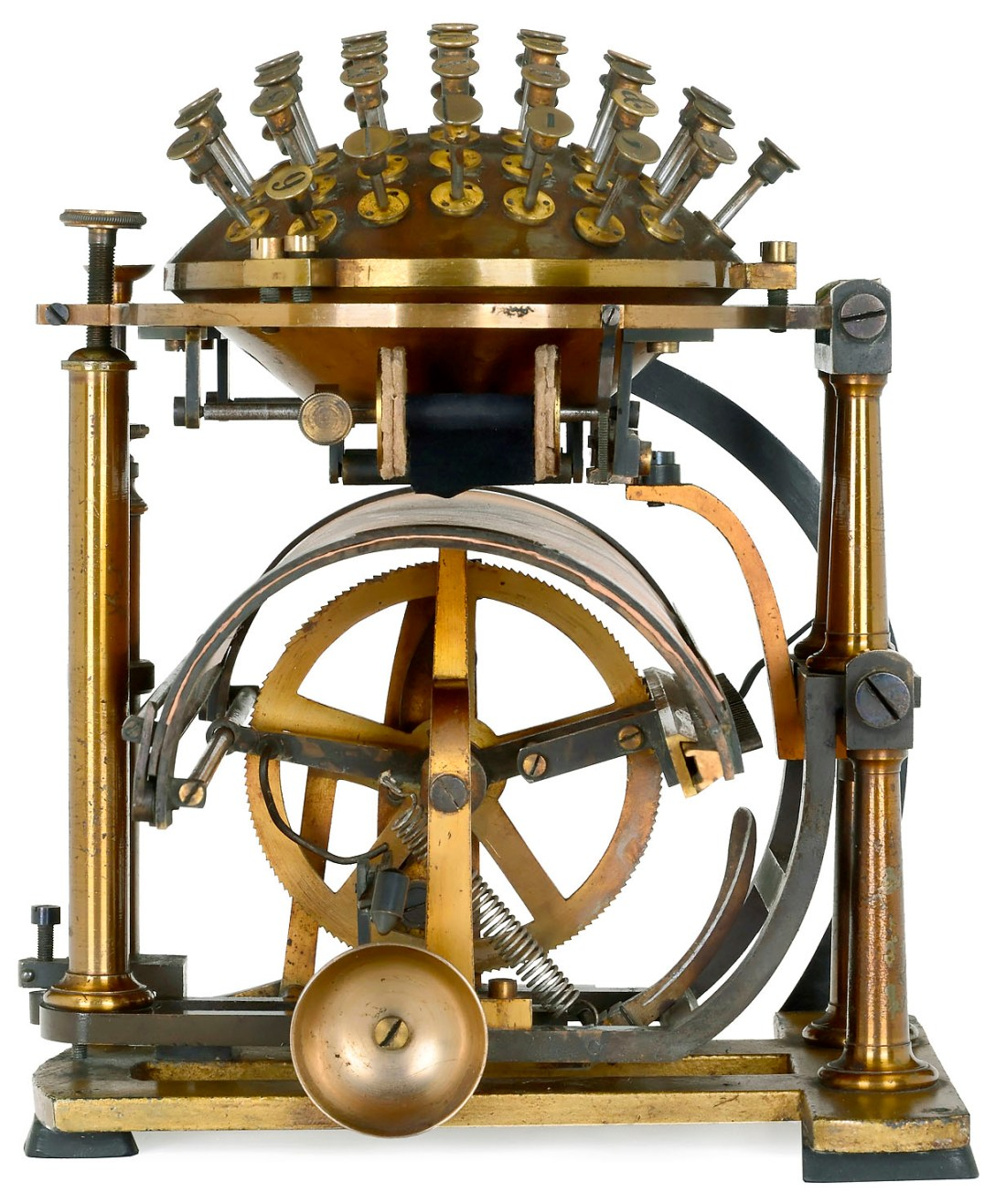 """A Malling-Hansen """"Writing Ball"""", an early typewriter, shown in profile."""