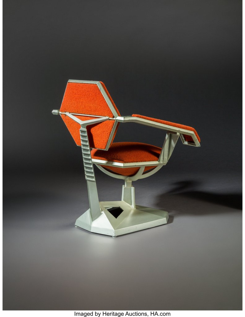A three-quarter rear view of the Frank Lloyd Wright Price Tower armchair.
