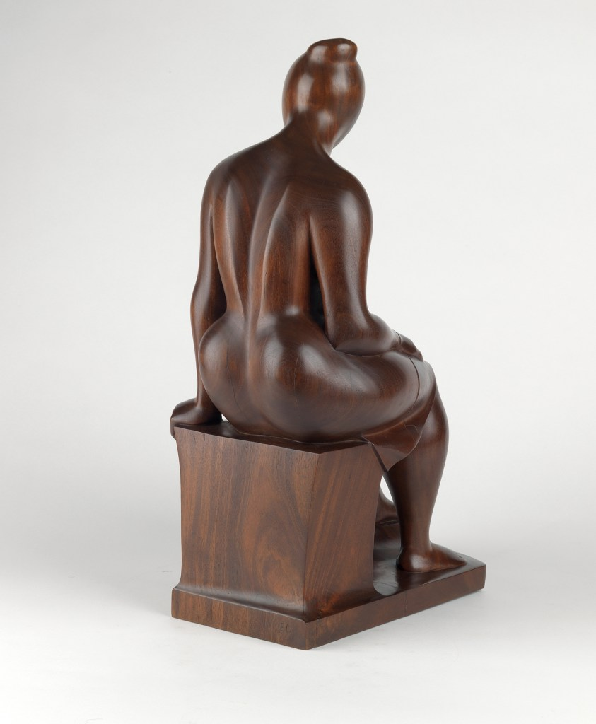 Seated Woman, a 1962 sculpture in mahogany by Elizabeth Catlett.