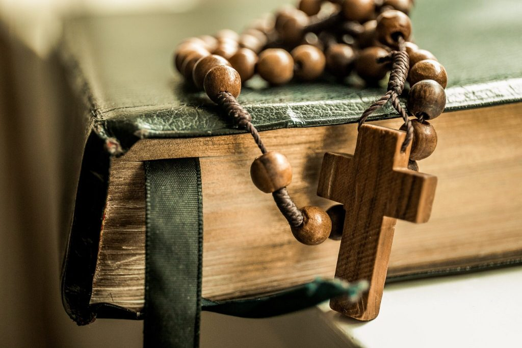 bible verses, black bible with brown rosary