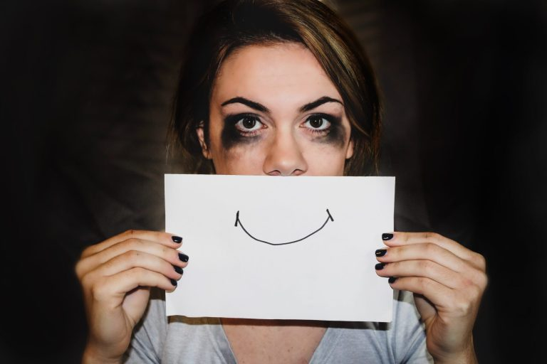 anxiety, woman holding paper smile