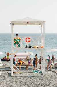 drowning, lifeguard on duty surrounded by people