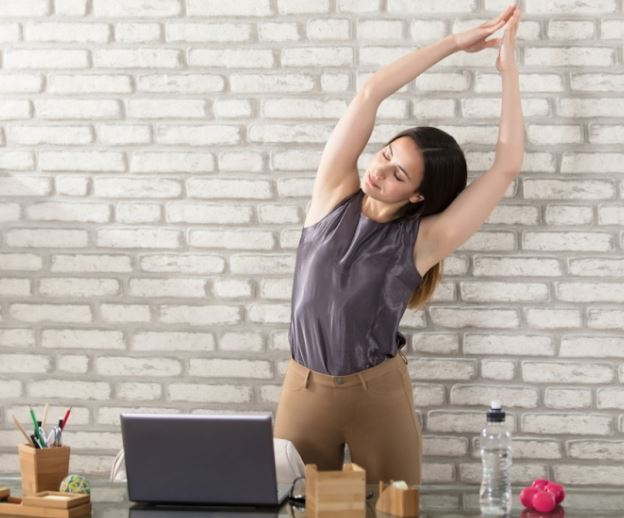 Burning Calories, woman stretching behind desk