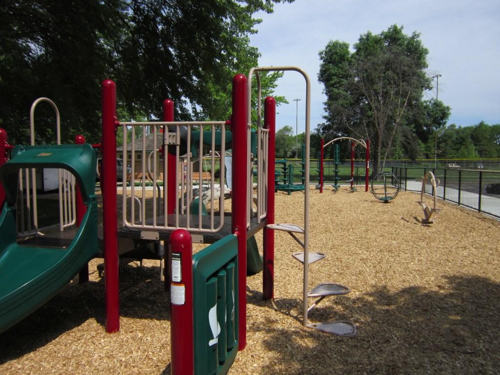 Playground, shock-absorbing surface