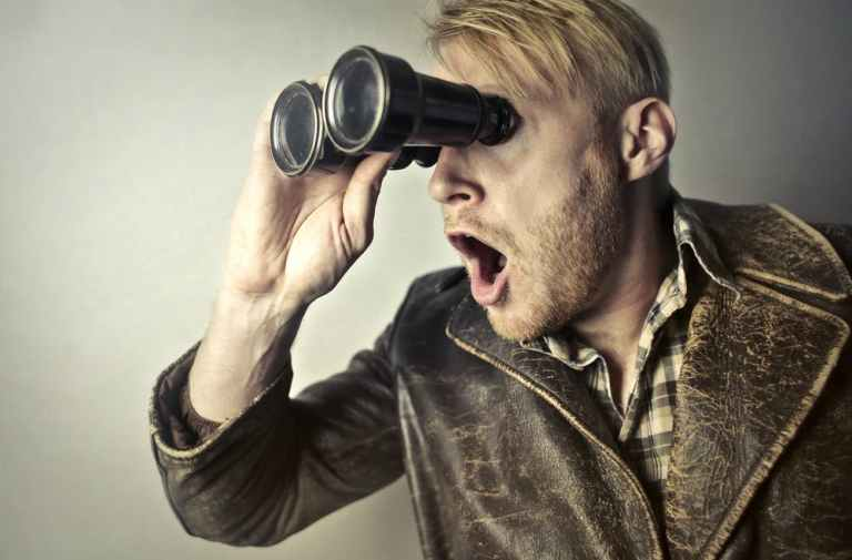 crazy things, man with open mouth looking into binoculars